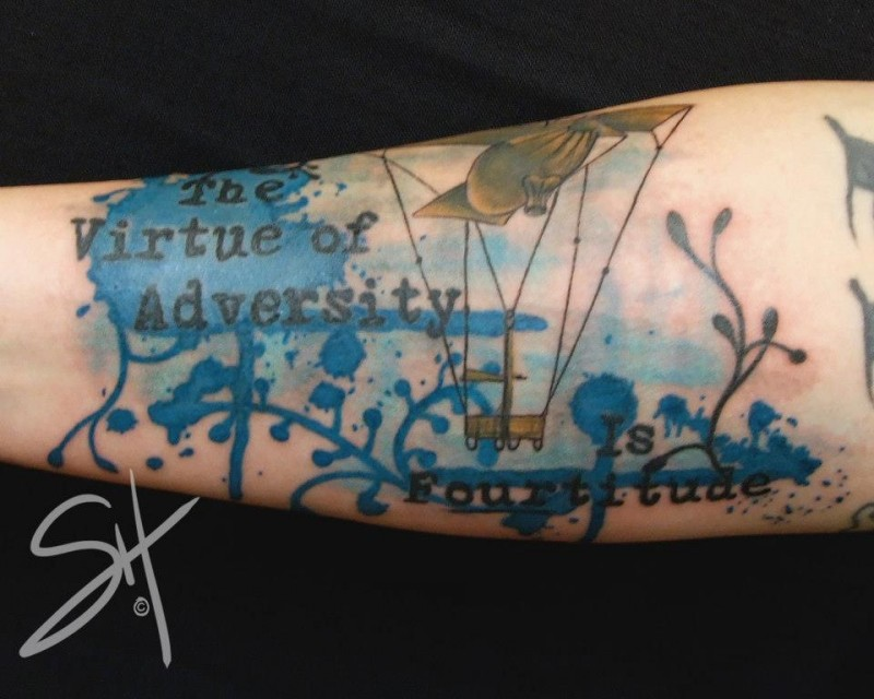 Abstract style colored forearm tattoo of lettering with airship