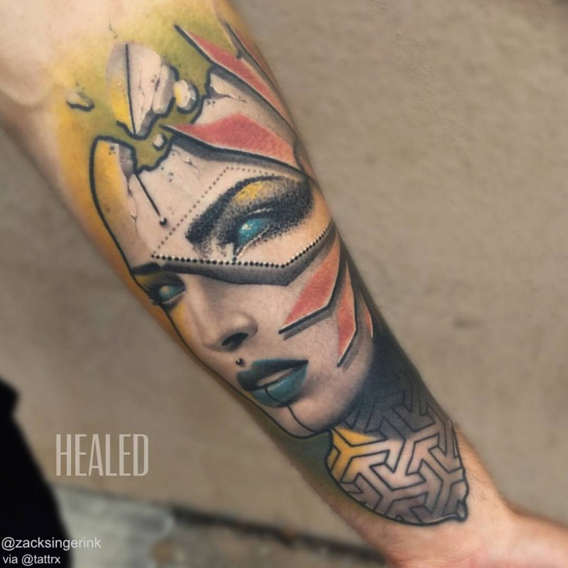 Abstract style colored forearm tattoo of woman portrait with various ornaments
