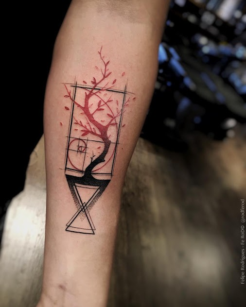 Abstract style colored forearm tattoo of geometrical figures with tree