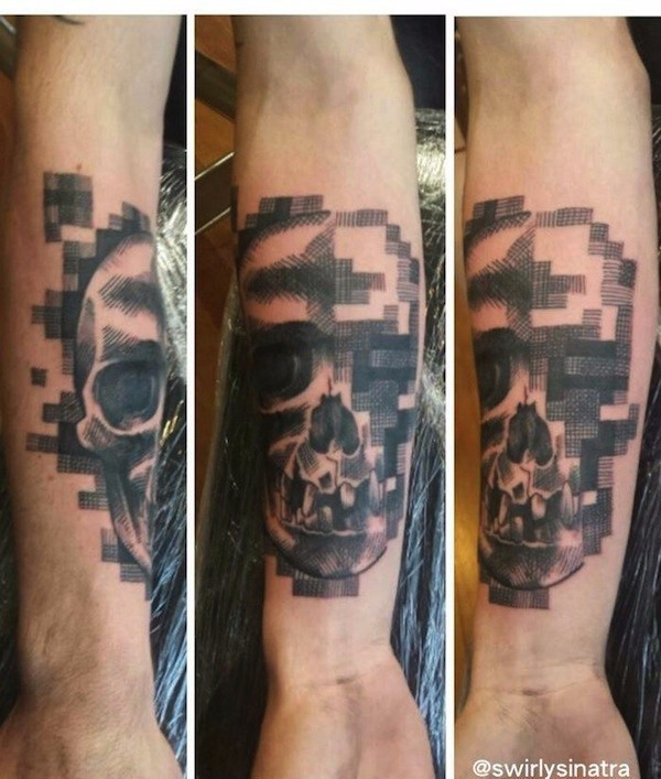 Abstract style colored forearm tattoo of human skull