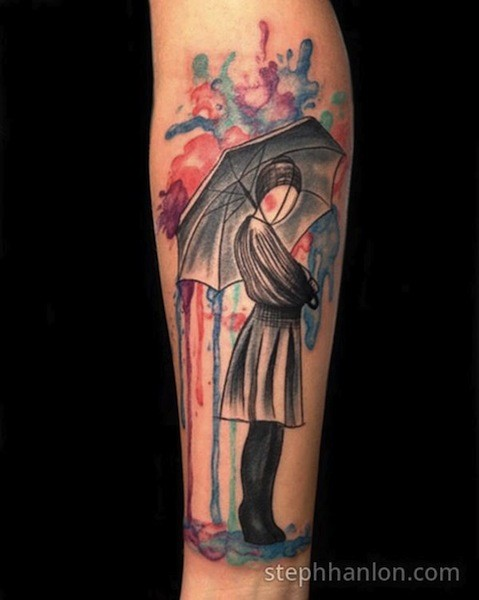 Abstract style colored forearm tattoo of woman with umbrella