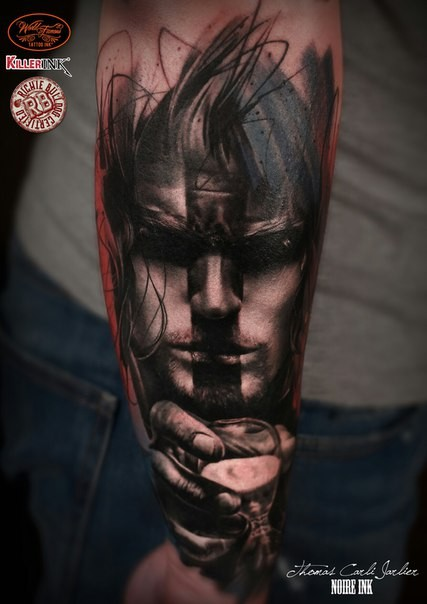 Abstract style colored forearm tattoo of human face