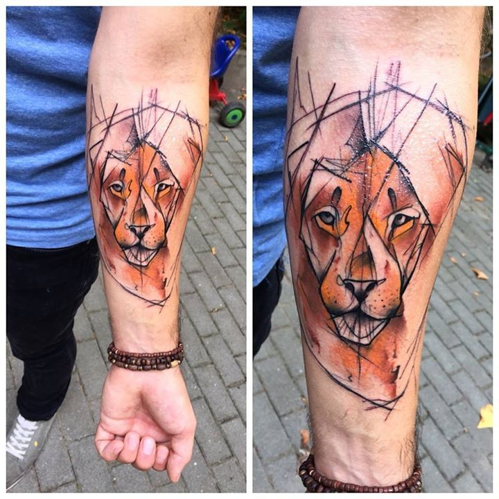 Abstract style colored forearm tattoo of lion face