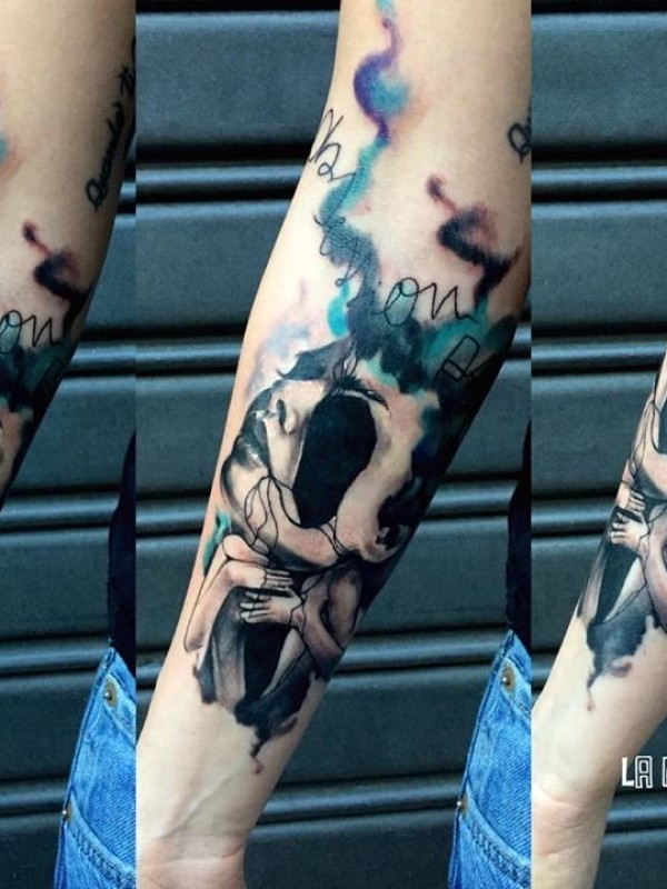 Abstract style colored forearm tattoo of woman face