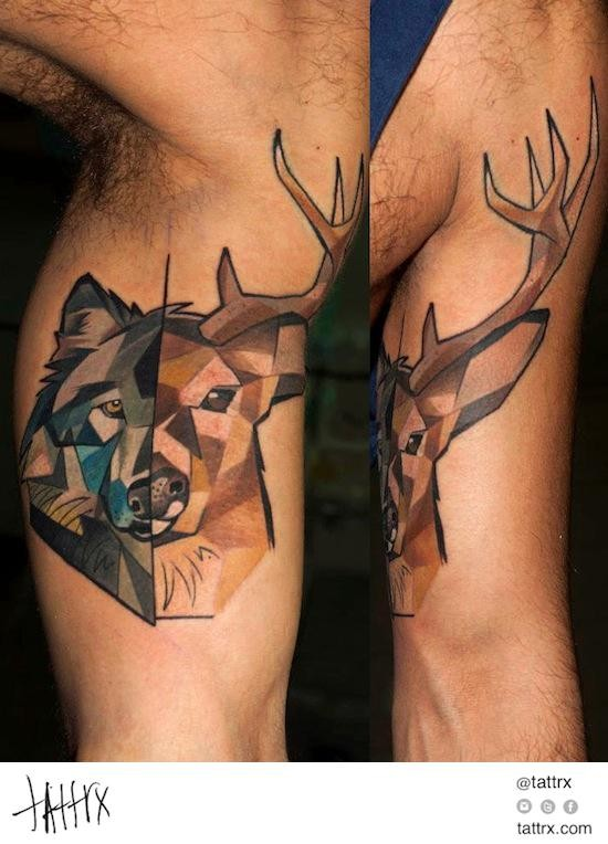 Abstract style colored half deer half wolf tattoo on biceps