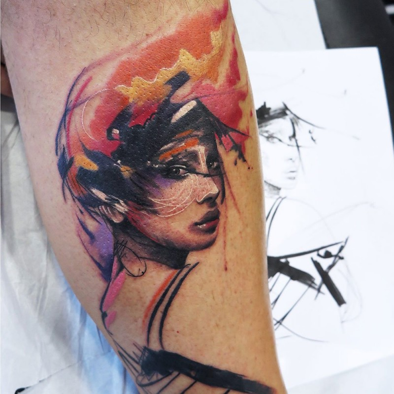 Abstract style colored leg tattoo of beautiful woman face
