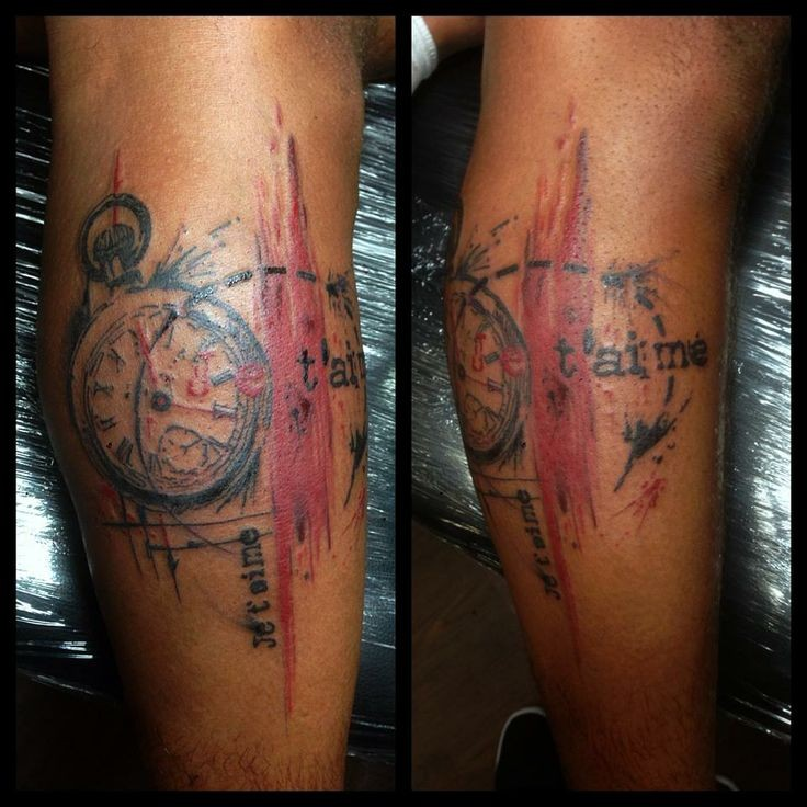 Abstract style colored leg tattoo of antic clock with lettering