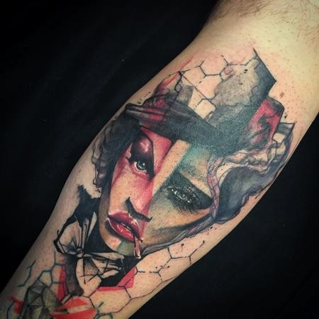 Abstract style colored leg tattoo of woman with bow