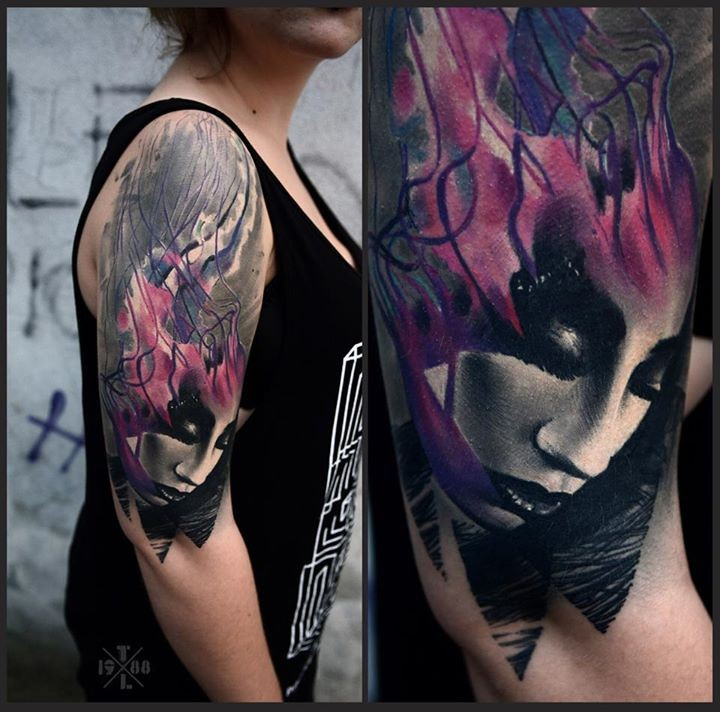 Abstract style colored mystical woman face tattoo on shoulder