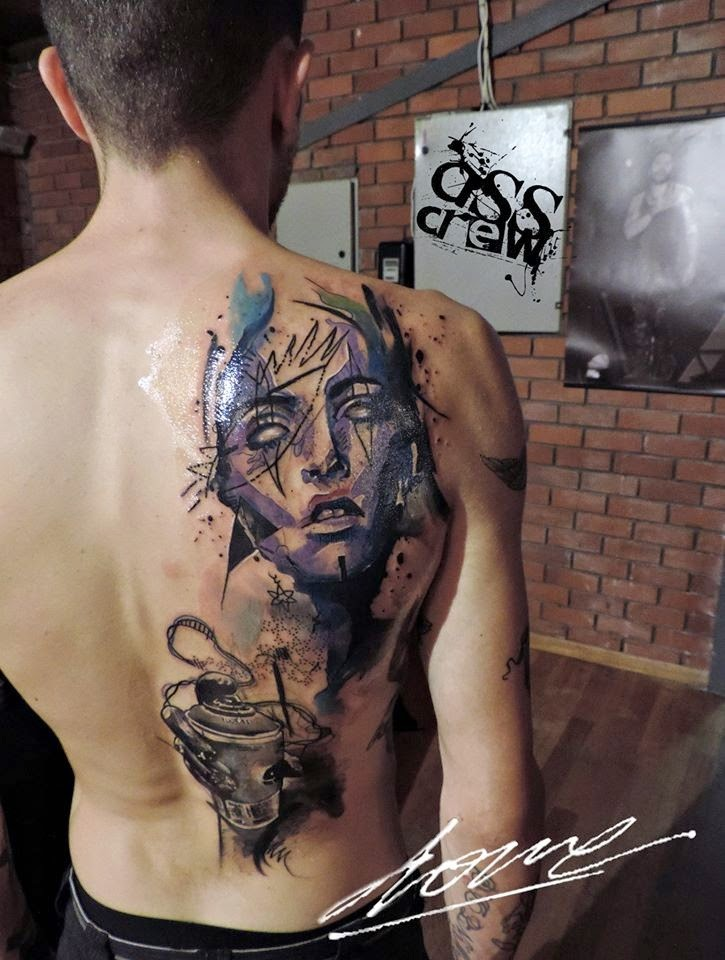 Abstract style colored scapular tattoo of woman face with ornaments