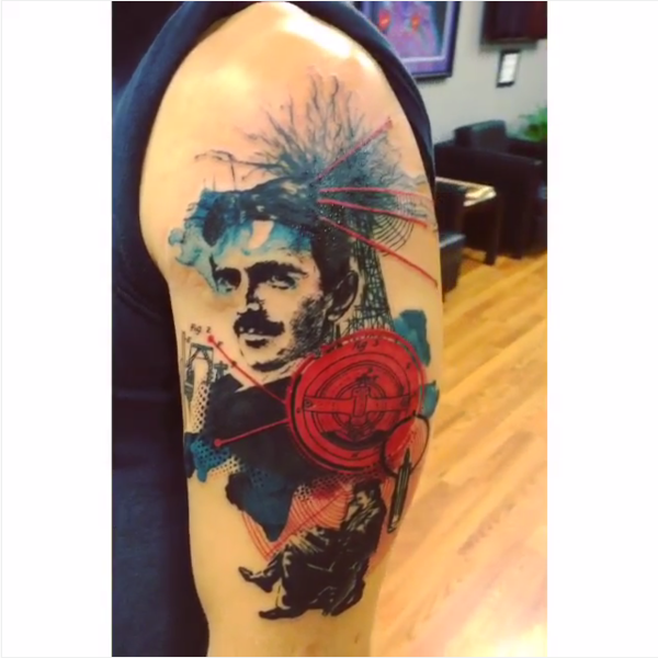 Abstract style colored shoulder tattoo of Nikola Tesla