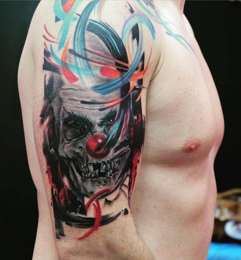 Abstract style colored shoulder tattoo of creepy clown skull