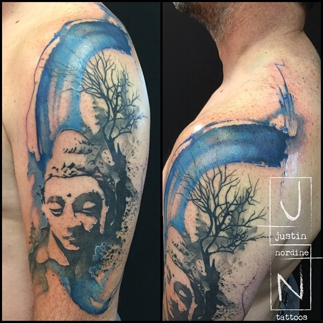 Abstract style colored shoulder tattoo of Buddha statue with tree