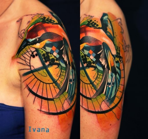 Abstract style colored shoulder tattoo of bird with ornaments