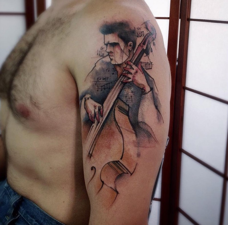 Abstract style colored shoulder tattoo of musician