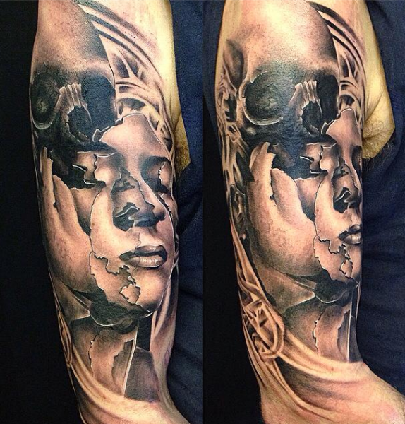 Abstract style colored shoulder tattoo of corrupted woman face combined with human skull
