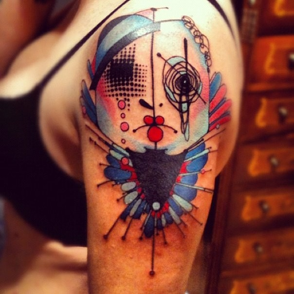 Abstract style colored shoulder tattoo of creepy fantasy monster