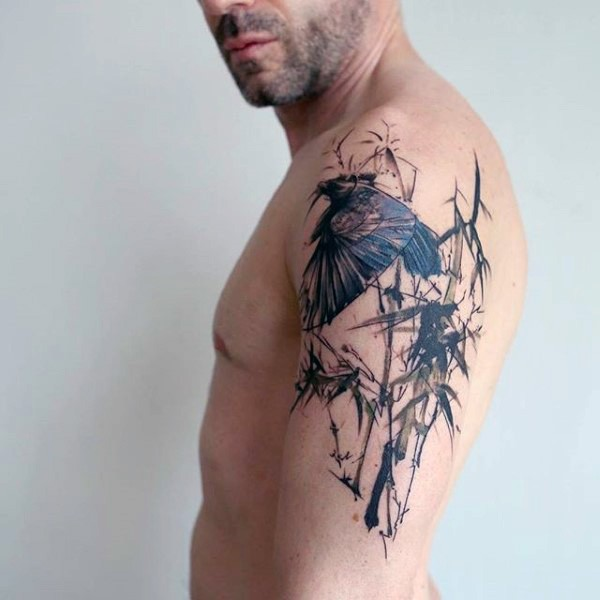 Abstract style colored shoulder tattoo of bird in jungle