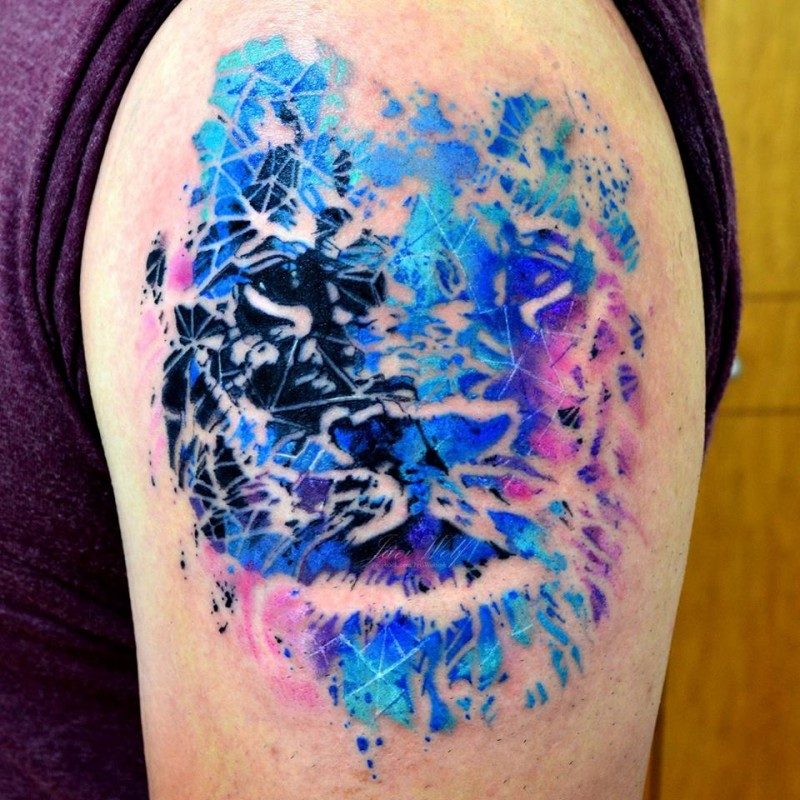 Abstract style colored shoulder tattoo of lion face
