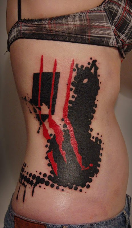 Abstract style colored side tattoo