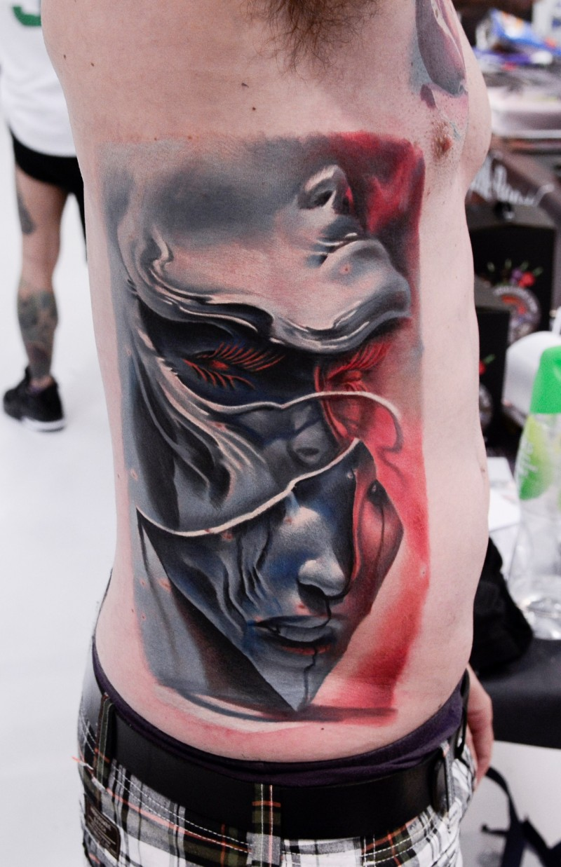 Abstract style colored side tattoo of mystical woman face