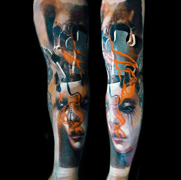 Abstract style colored sleeve tattoo of woman with puzzle