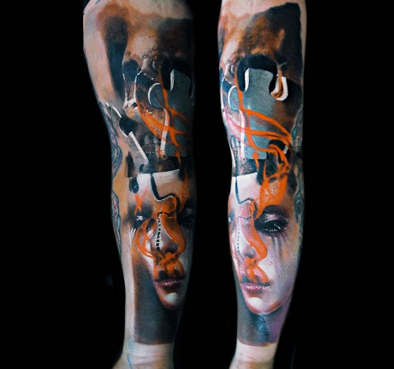 Abstract style colored sleeve tattoo of woman mask with puzzle piece