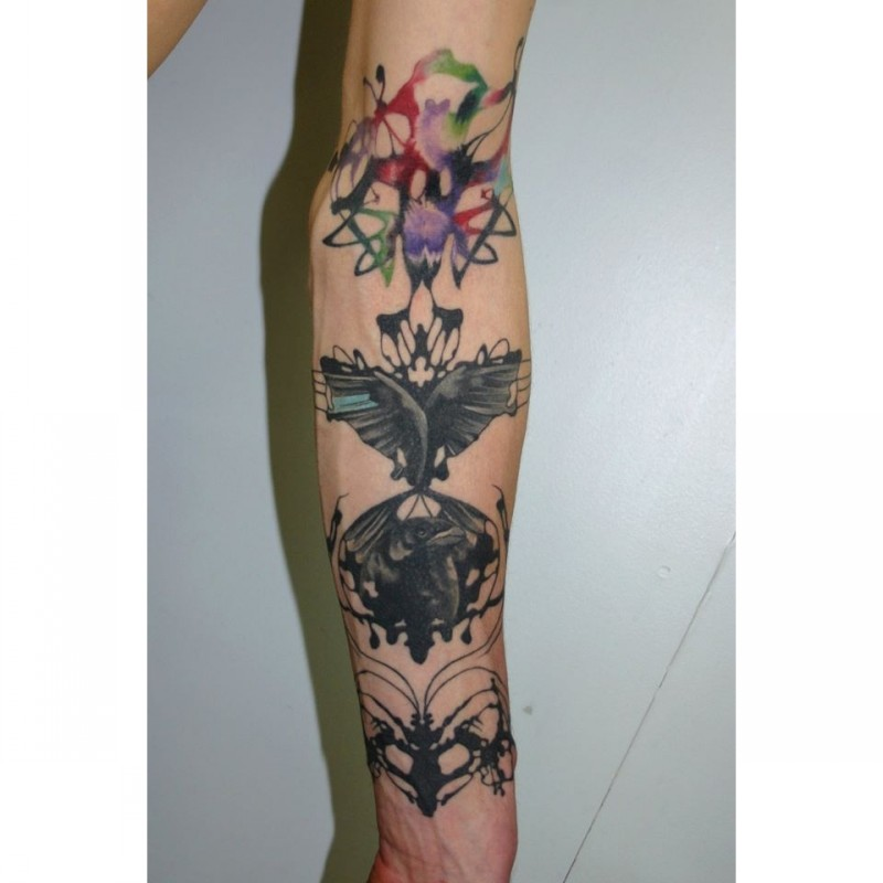 Abstract style colored sleeve tattoo of butterfly with ornaments