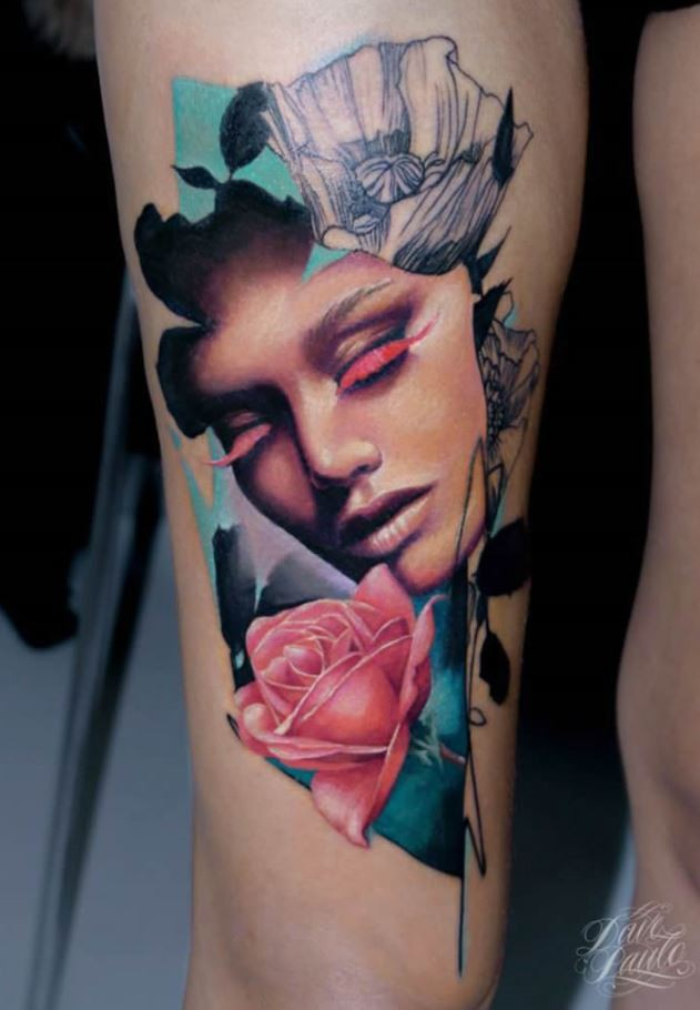 Abstract style colored thigh tattoo fo woman face with flowers