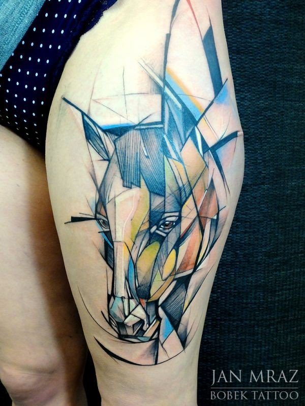 Abstract style colored thigh tattoo of horse head
