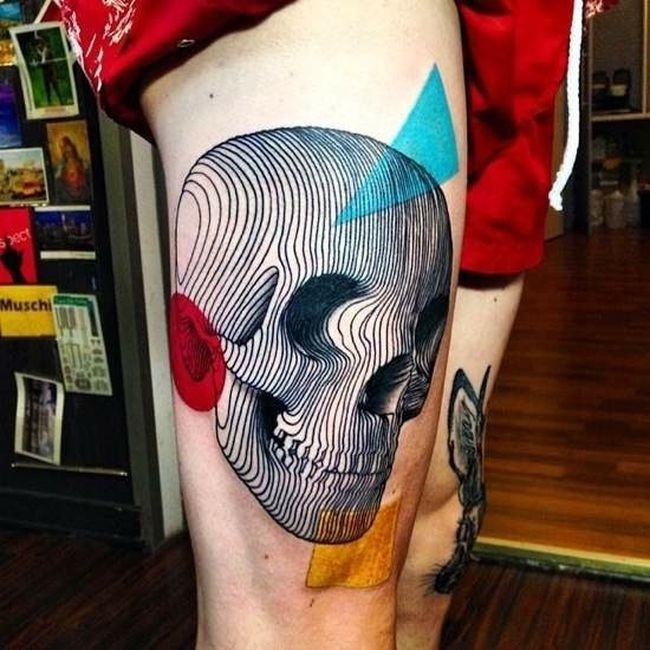 Abstract style colored thigh tattoo of human skull with geometrical figures