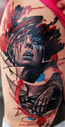 Abstract style colored thigh tattoo of woman face with ornaments