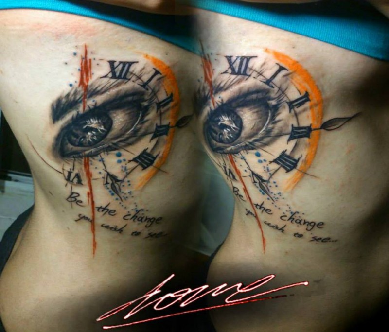 Abstract style colored thigh tattoo of eye with clock