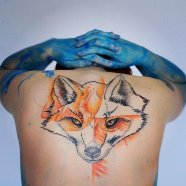 Abstract style colored upper back tattoo of fox head
