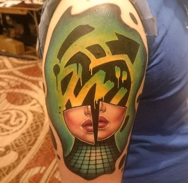 Abstract style colored woman face parts tattoo on shoulder