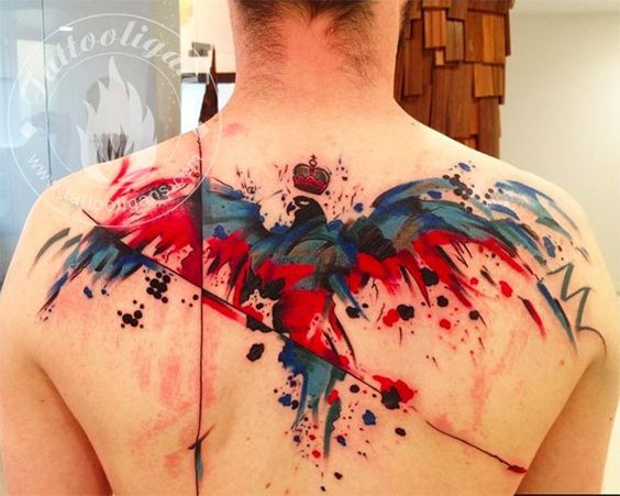 Abstract style colorful big bird with crown tattoo on upper back