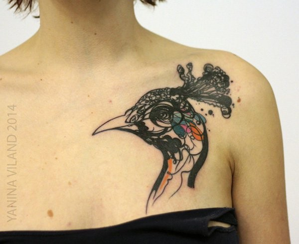 Abstract style colorful chest tattoo of peacock head