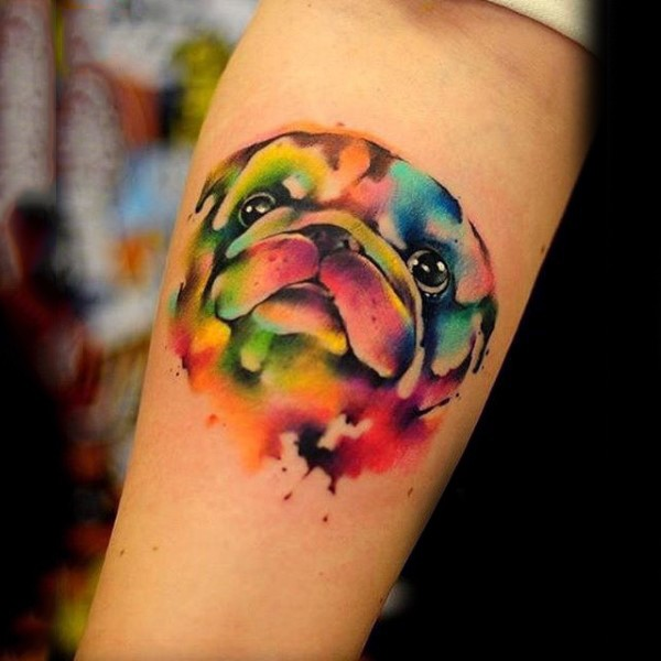 Abstract style colorful dog portrait tattoo on arm