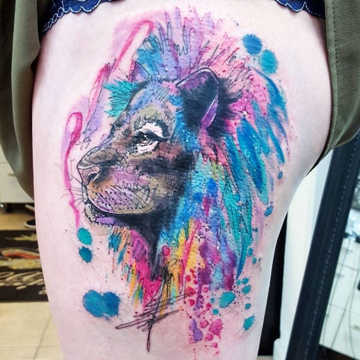 Abstract style colorful thigh tattoo of lion head