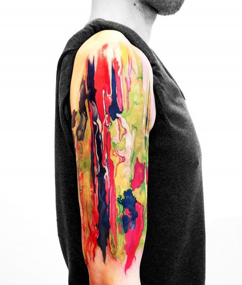 Abstract style multicolored shoulder tattoo