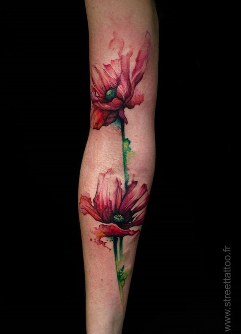 Abstract style multicolored sleeve tattoo of beautiful flowers