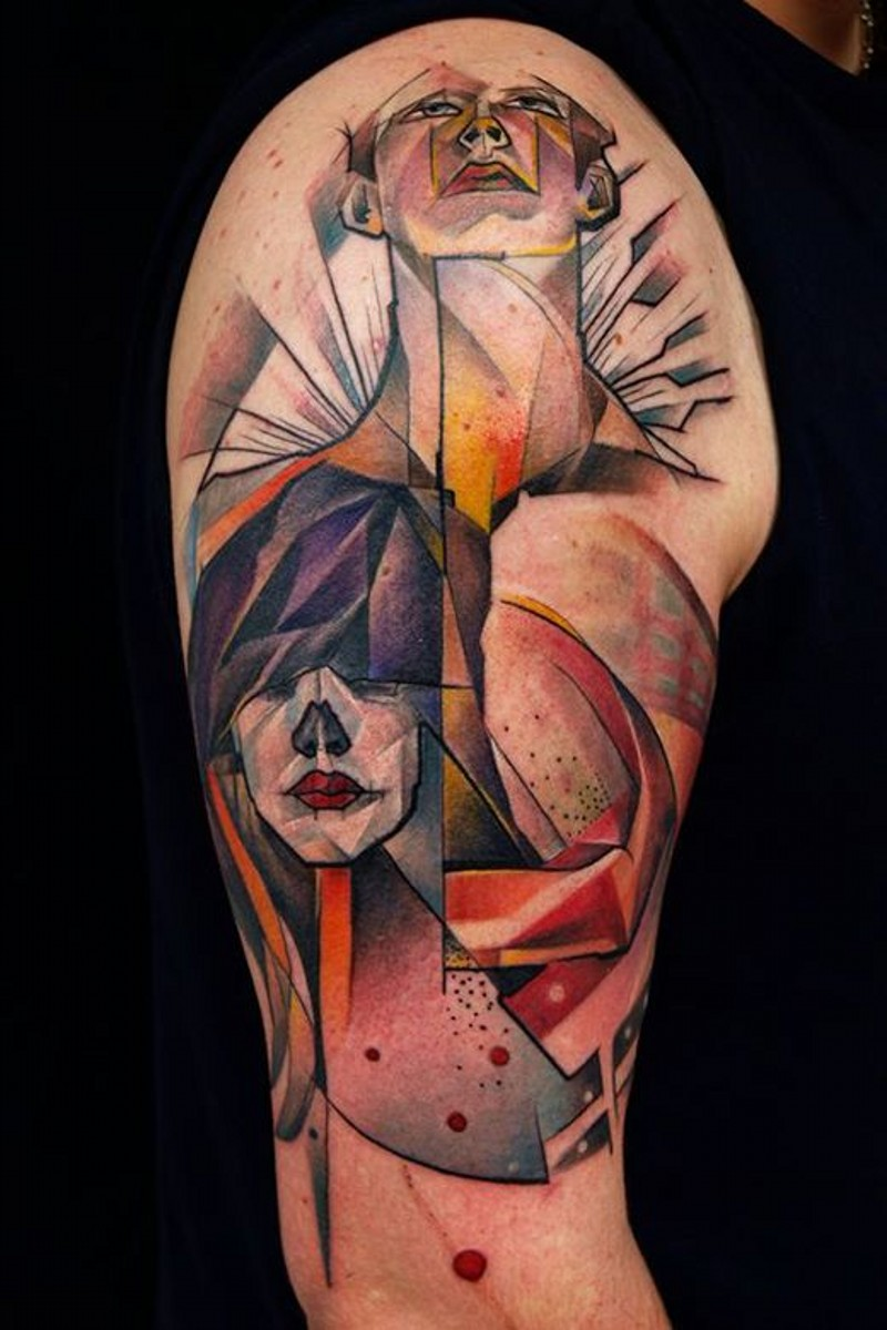 Abstract style painted and colored tribal people tattoo on shoulder