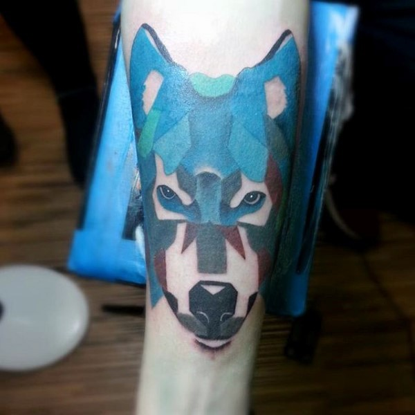 Abstract style painted colorful wolf tattoo on arm