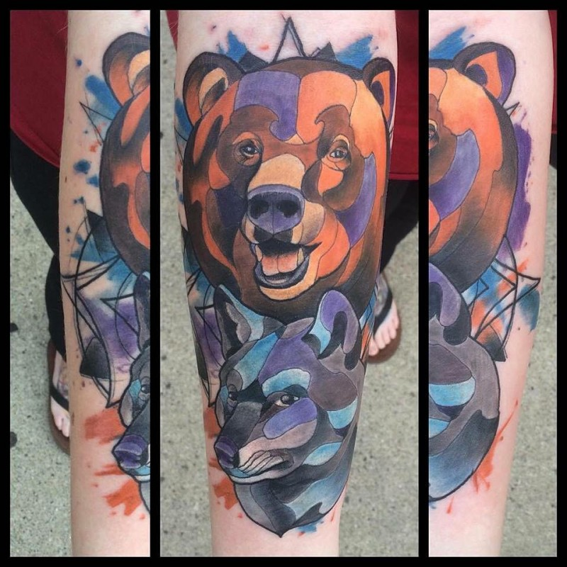 Abstract style watercolor like big bear head tattoo on forearm with wolf