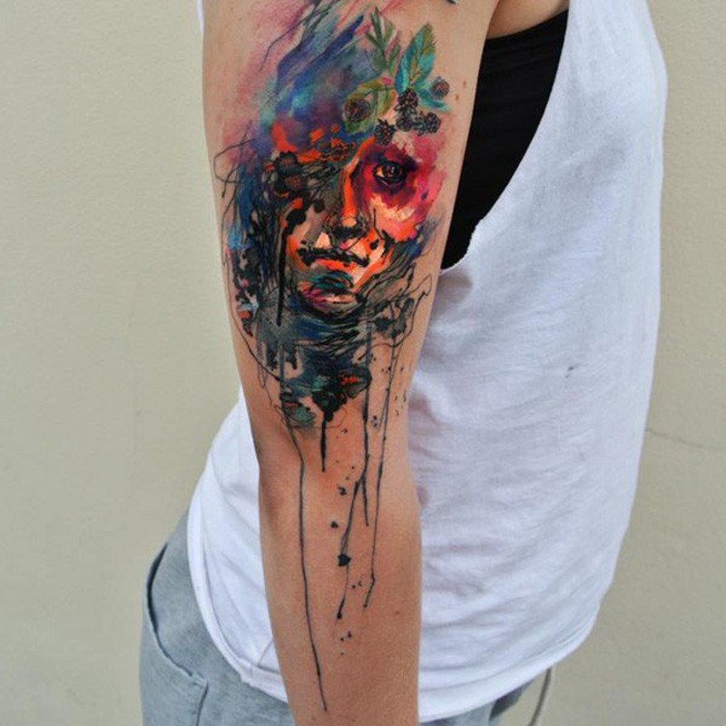 Abstract style watercolor shoulder tattoo of woman portrait with berries