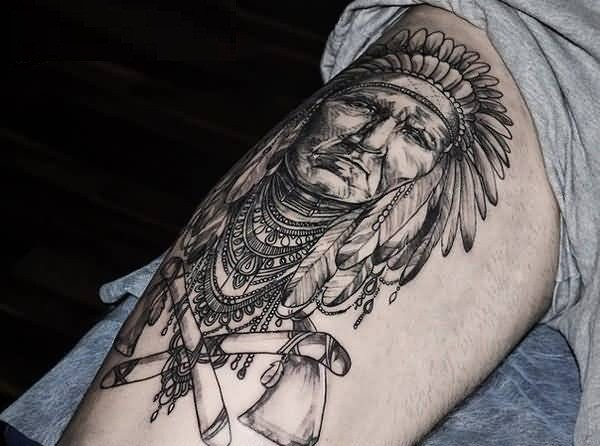 Accurate black and white detailed Indian portrait on thigh with crossed axes