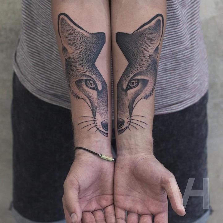 Accurate cartoon like forearm tattoo by Valentin Hirsch of split fox head