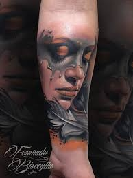 Accurate colored and detailed mystical sad woman portrait tattoo on forearm with feather