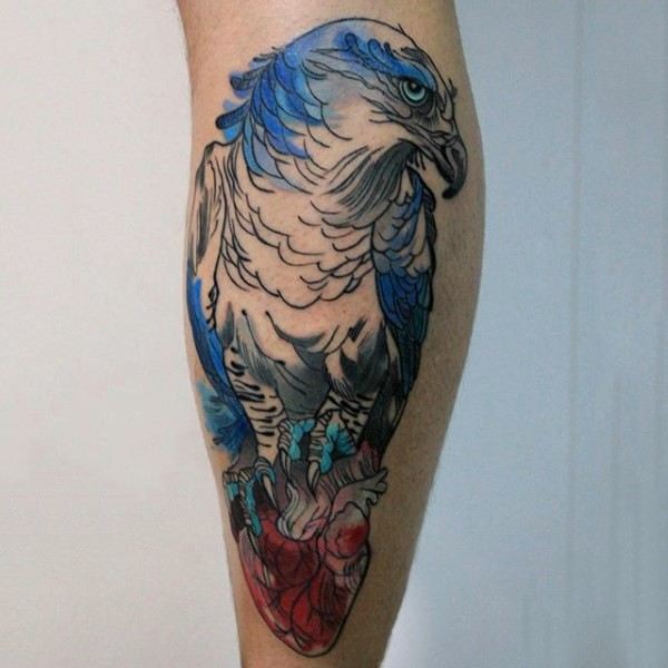 Accurate designed and colored big eagle with heart tattoo on leg