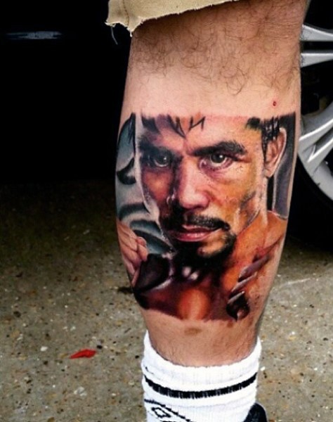 Accurate designed and colored  famous  boxer tattoo on leg